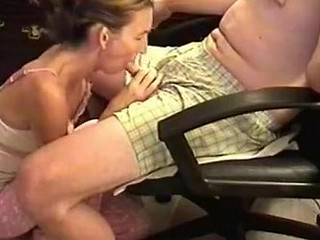 This babe was a bit shy cuz the camera was shooting, but also horny. I sat in an armchair and she knelt in front to wrap her lips around my cock. Then, she performed one of the most good blowjobs ever.